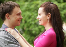 Closeup portrait of smiling young couple in love Stock Photography