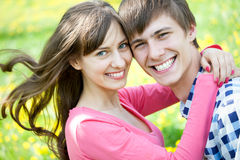 Closeup portrait of smiling young couple Stock Photography