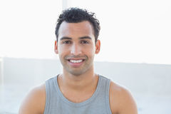 Closeup portrait of a smiling young man in vest Royalty Free Stock Photo
