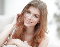 Closeup portrait of a smiling young woman with light make-up Royalty Free Stock Images