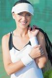 Closeup Portrait of Smilling Female Tennis Woman Holding Tennis Stock Image
