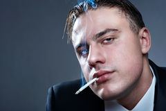 Closeup portrait of smoking man Stock Photography