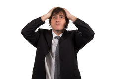 Closeup portrait, stressed young business man, hands on head with bad headache, isolated background. Royalty Free Stock Photos