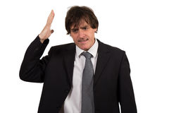 Closeup portrait, stressed young business man, hands on head with bad headache, isolated background. stock image