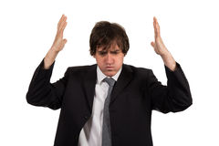 Closeup portrait, stressed young business man, hands on head with bad headache, isolated background. stock photo