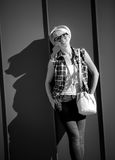 Closeup portrait of stylish hipster girl leaning against wall Royalty Free Stock Photo