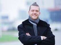 Closeup.portrait of a successful man on blurred background. City royalty free stock image