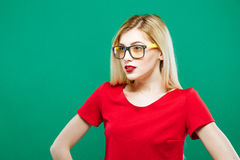 Closeup Portrait of Surprised Girl Wearing Short Red Top and Eyeglasses. Sensual Pretty Blonde with Long Hair is Posing Stock Image