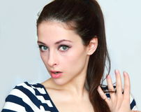 Closeup portrait of a surprised young woman Stock Images