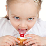 Closeup portrait of sweet little girl with cake Royalty Free Stock Image