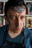 Closeup portrait of tattoo master in studio Royalty Free Stock Photos