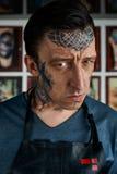 Closeup portrait of tattooed in his studio Stock Photos