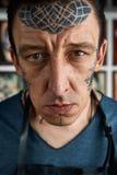 Closeup portrait of tattooist in studio Stock Photos