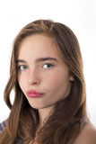 Closeup portrait of a teenage girl kissing lips isolated on whit Stock Photos