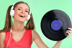 Closeup portrait of teenager with headphones listening music. Royalty Free Stock Image