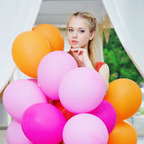Closeup portrait of tender young woman with balloons Royalty Free Stock Photos