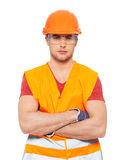 Portrait of thinking handyman in orange uniform Stock Photography
