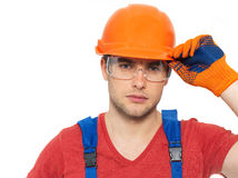 Portrait of thinking handyman in uniform Royalty Free Stock Photos