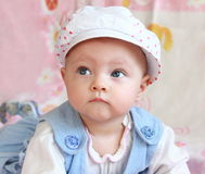 Closeup portrait of thoughtful baby royalty free stock photography