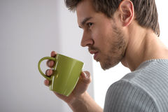 Closeup portrait of thoughtful man having coffee. Stock Image