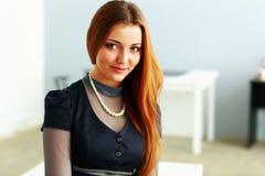 Closeup portrait of a thoughtful redhead woman Stock Photo