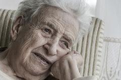 Closeup portrait of thoughtful senior woman Royalty Free Stock Images