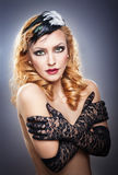 Closeup portrait of a topless blonde woman wearing black lace gloves. Fashionable portrait of the long blond-haired girl with long gloves.Portrait of beautiful Royalty Free Stock Images