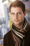 Closeup portrait of trendy guy. Wearing scarf, looking at camera Royalty Free Stock Images