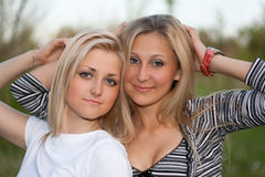 Closeup portrait of two attractive young women Stock Images
