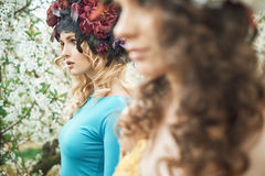 Closeup portrait of two beautiful ladies Royalty Free Stock Images