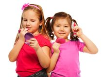 Two little girls make up Royalty Free Stock Photos