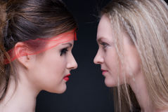 Closeup portrait of two girls: good & evil Stock Image