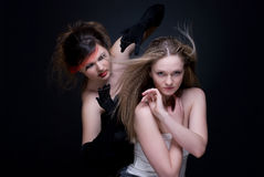 Closeup portrait of two girls: good & evil Stock Photos
