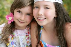 Closeup portrait of two little girl sisters Royalty Free Stock Photos