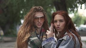 Closeup portrait of two redheaded girls. girlfriends fooling around and having fun. slow motion stock footage