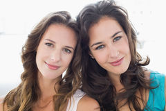 Closeup portrait of two smiling young female friends Stock Images