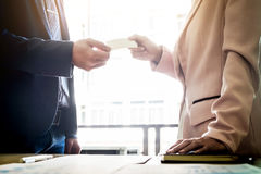 Closeup portrait of two successful business executive exchanging Royalty Free Stock Images
