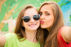 Closeup portrait of two teenage girls friends in hipster outfit Royalty Free Stock Photography