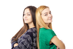 Closeup portrait of two teenage girls standing back to back with Stock Images