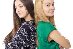 Closeup portrait of two teenage girls standing back to back with Stock Photos