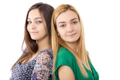 Closeup portrait of two teenage girls standing back to back Royalty Free Stock Photography