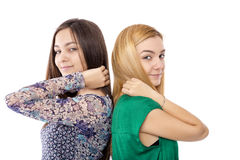 Closeup portrait of two teenage girls standing back to back Stock Photo