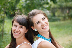 Closeup portrait of two young females Royalty Free Stock Images
