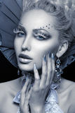 Closeup portrait of winter queen. Closeup portrait of beautiful young woman dressed as winter queen. Creative makeup. Over black background. Copy space Stock Images