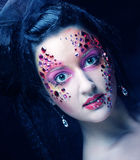 Closeup portrait of woman with artistic make-up Stock Photos
