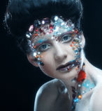 Closeup portrait of woman with artistic make-up. Stock Photography
