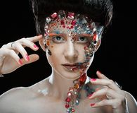 Closeup portrait of woman with artistic make-up. Stock Photo
