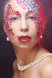 Closeup portrait of woman with artistic make-up. Stock Images