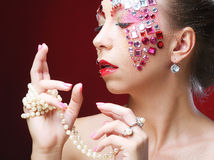 Closeup portrait of woman with artistic make-up. Stock Image