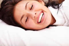 Closeup portrait of a woman in bed Stock Photos